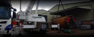 Industrial boiler being removed with large crane