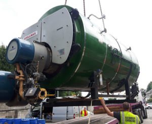 Green Boiler being loaded on to flatbed lorry