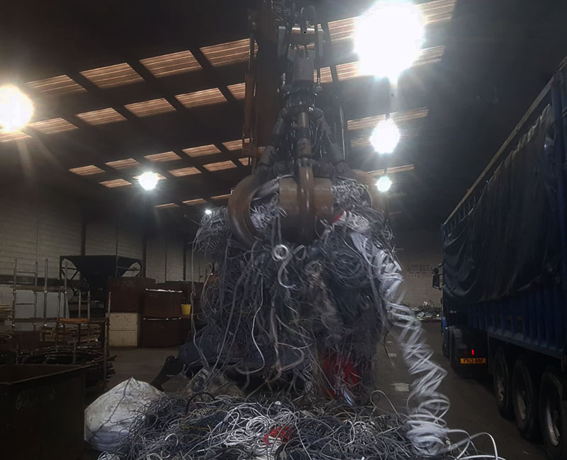 Crane lifting household wire in warehouse
